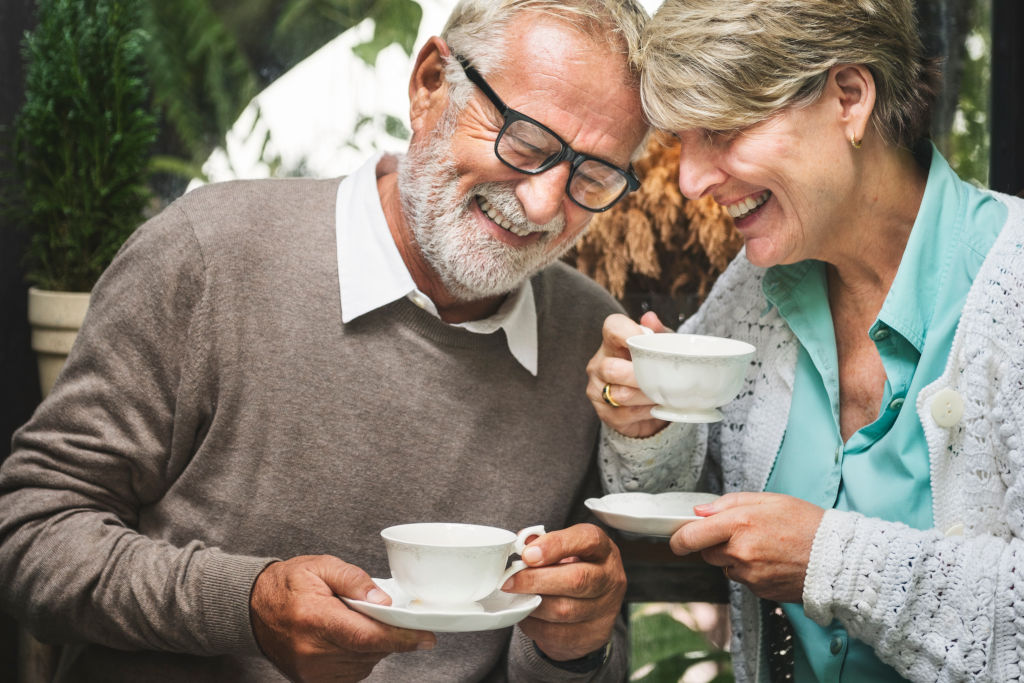 Older couple drinking tea and laughing